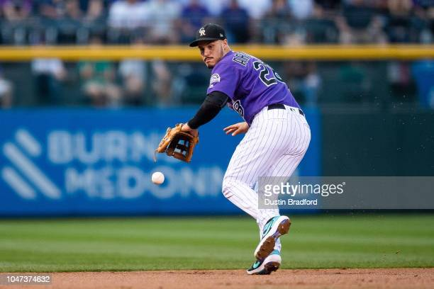 Nolan Arenado of the Colorado Rockies fields a ground ball in the first inning of a game against the Washington Nationals at Coors Field on September...