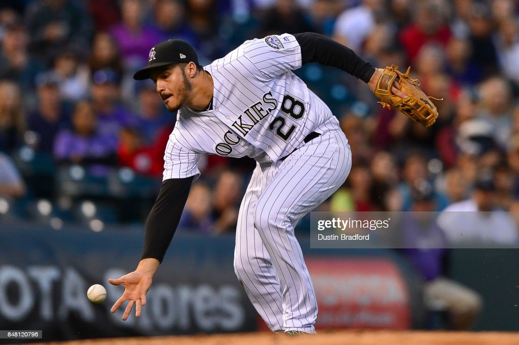 Nolan Arenado #28 of the Colorado Rockies fields a soft ground ball barehanded against the San Diego Padres at Coors Field on September 16, 2017 in Denver, Colorado.