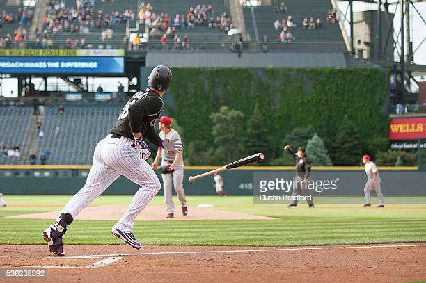 Nolan Arenado of the Colorado Rockies flips his bat and watches the flight of a first inning tworun home run off of Jon Moscot of the Cincinnati Reds...