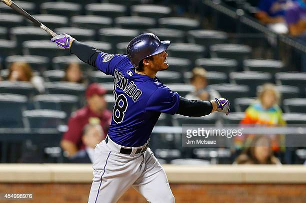 Nolan Arenado of the Colorado Rockies follows through on an eighth inning home run against the New York Mets at Citi Field on September 8 2014 in the...