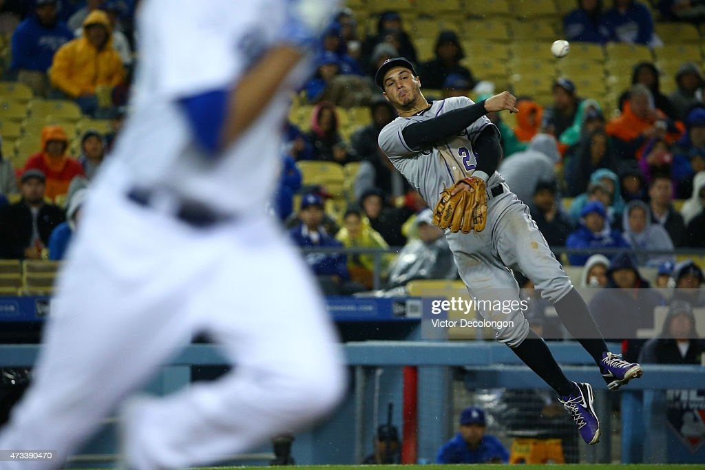 Nolan Arenado #28 of the Colorado Rockies follows through on his throw from the third base line on an infield ground ball hit by Scott Van Slyke #33 of the Los Angeles Dodgers in the fifth inning during the MLB game at Dodger Stadium on May 14, 2015 in Los Angeles, California.