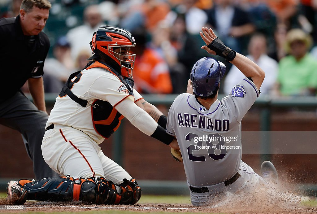 Nolan Arenado #28 of the Colorado Rockies gets tagged out at home-plate by Hector Sanchez #29 of the San Francisco Giants during the six inning at AT&T Park on September 11, 2013 in San Francisco, California. Arenado was attempting to score from second base on a base hit by Jonathan Herrera #18 (not pictured).