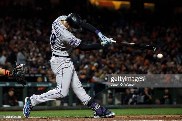 Nolan Arenado of the Colorado Rockies hits a double against the San Francisco Giants during the eighth inning at ATT Park on September 15 2018 in San...
