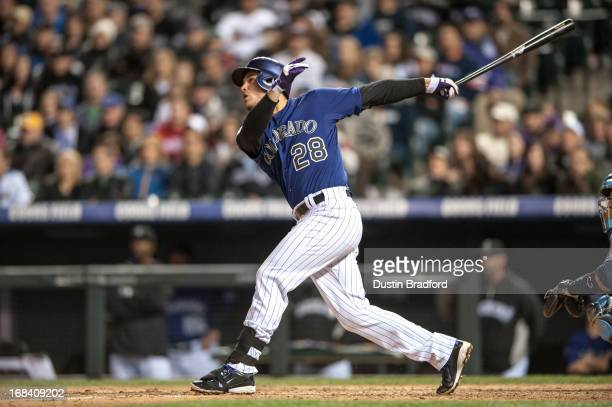 Nolan Arenado of the Colorado Rockies hits a grand slam home run in the seventh inning of a game against the Tampa Bay Rays at Coors Field on May 4...