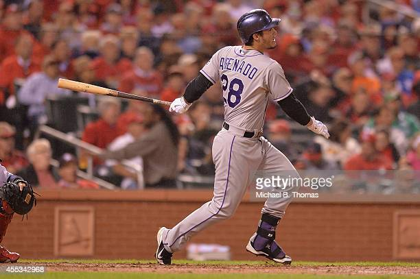Nolan Arenado of the Colorado Rockies hits a RBI double in the third inning against the St Louis Cardinals at Busch Stadium on September 12 2014 in...