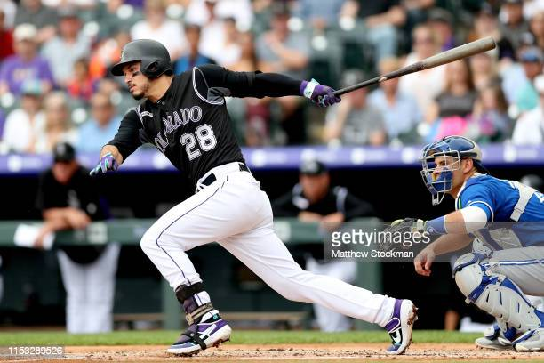Nolan Arenado of the Colorado Rockies hits a single in the first inning against the Toronto Blue Jays at Coors Field on June 02 2019 in Denver...