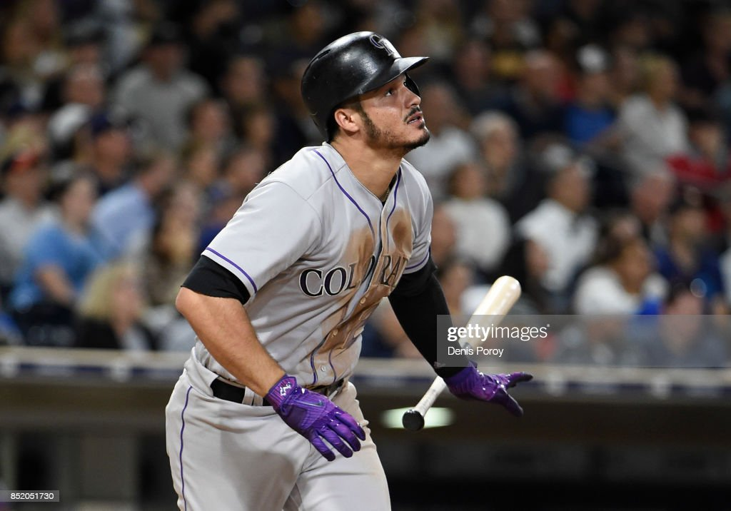 Nolan Arenado #28 of the Colorado Rockies hits a solo home run during the fifth inning of a baseball game against the San Diego Padres at PETCO Park on September 22, 2017 in San Diego, California.