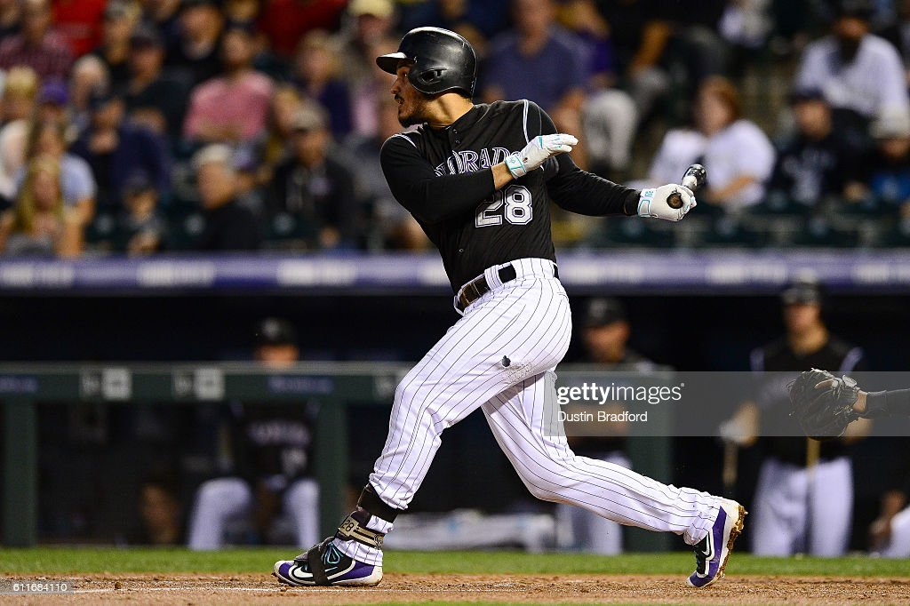 Nolan Arenado #28 of the Colorado Rockies hits a third inning leadoff double against the Milwaukee Brewers at Coors Field on September 30, 2016 in Denver, Colorado.