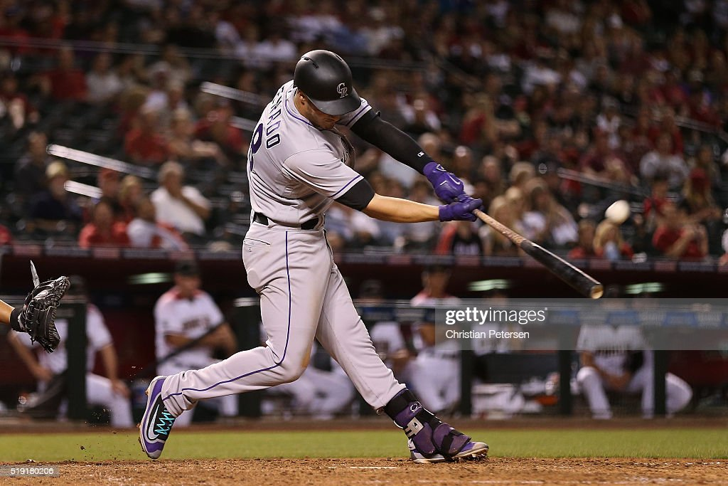 Nolan Arenado #28 of the Colorado Rockies hits a three-run home run against the Arizona Diamondbacks during the eighth inning of the MLB opening day game at Chase Field on April 4, 2016 in Phoenix, Arizona.