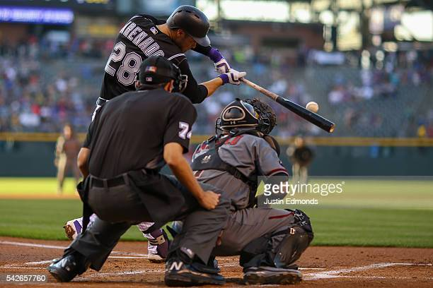 Nolan Arenado of the Colorado Rockies hits an RBI double during the first inning against the Arizona Diamondbacks at Coors Field on June 23 2016 in...