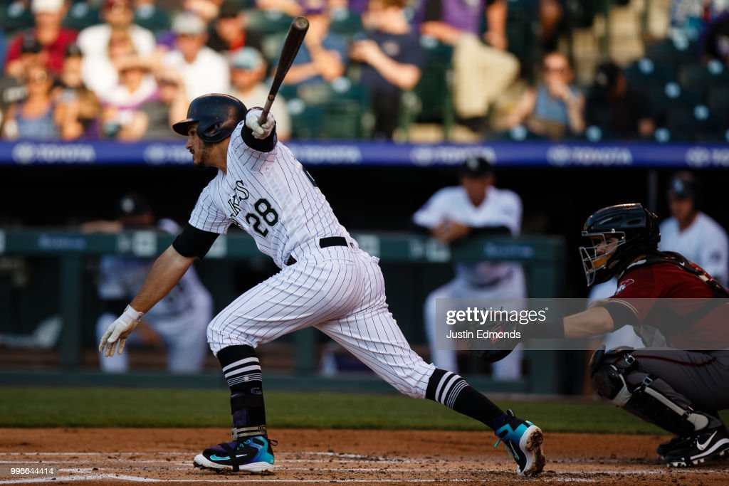 Nolan Arenado #28 of the Colorado Rockies hits an RBI single during the first inning against the Arizona Diamondbacks at Coors Field on July 11, 2018 in Denver, Colorado.