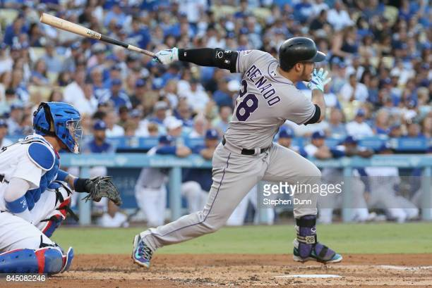 Nolan Arenado of the Colorado Rockies hits an RBI single in the second inning against the Los Angeles Dodgers at Dodger Stadium on September 9 2017...