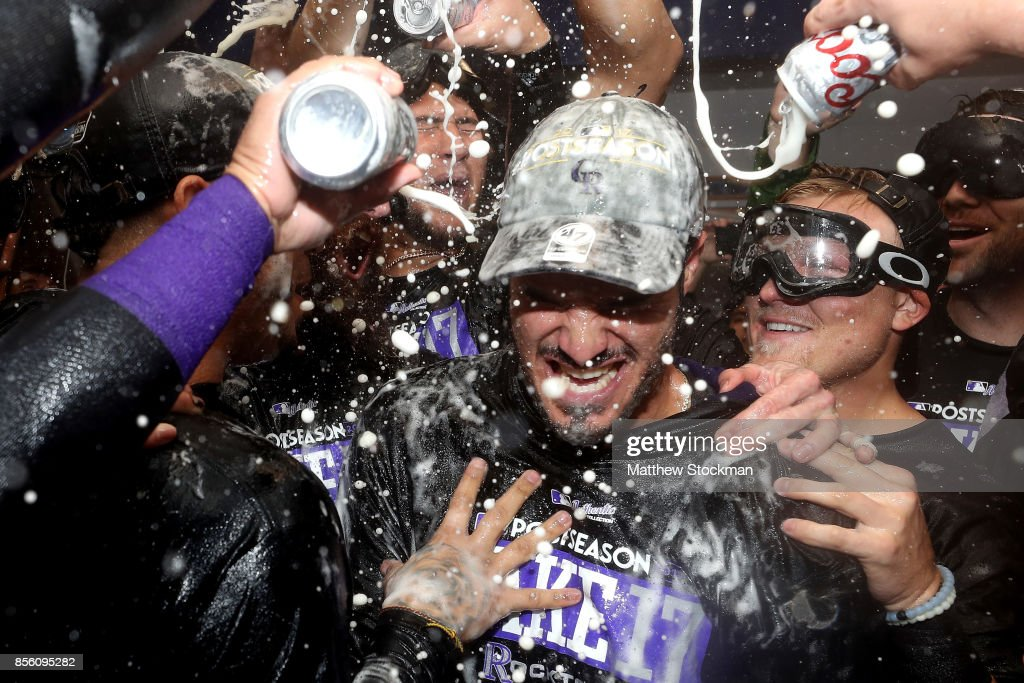 Nolan Arenado #28 of the Colorado Rockies is doused by his teammates in the lockerroom at Coors Field on September 30, 2017 in Denver, Colorado. Although losing 5-3 to the Los Angeles Dodgers, the Rockies celebrated clinching a wild card spot in the post season.