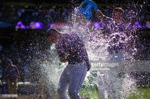 Nolan Arenado of the Colorado Rockies is doused with sports drink by Ryan McMahon after a walkoff tworun home run against the Arizona Diamondbacks at...