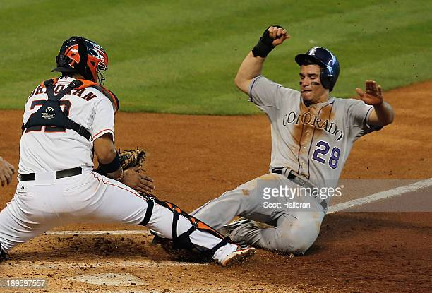 Nolan Arenado of the Colorado Rockies is tagged out at home during the third inning by Carlos Corporan of the Houston Astros at Minute Maid Park on...