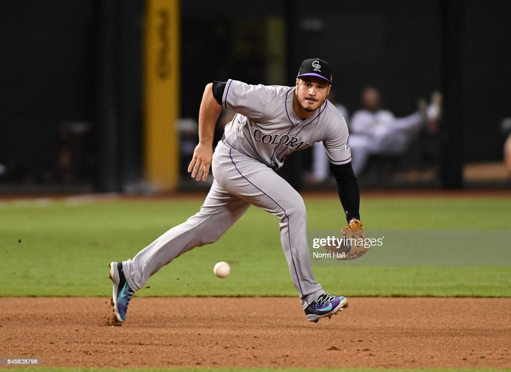 Nolan Arenado #28 of the Colorado Rockies makes a play on a ground ball hit by Brandon Drury #27 of the Arizona Diamondbacks during the fourth inning at Chase Field on September 11, 2017 in Phoenix, Arizona. Drury was forced out at first base.