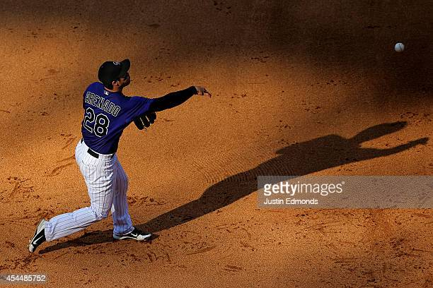 Nolan Arenado of the Colorado Rockies makes a throw to first base for the first out of the fifth inning against the San Francisco Giants at Coors...