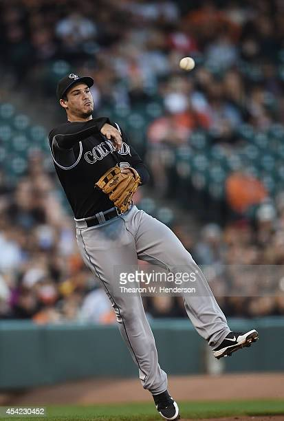 Nolan Arenado of the Colorado Rockies makes an off balance throw to first base to get Angel Pagan of the San Francisco Giants in the bottom of the...