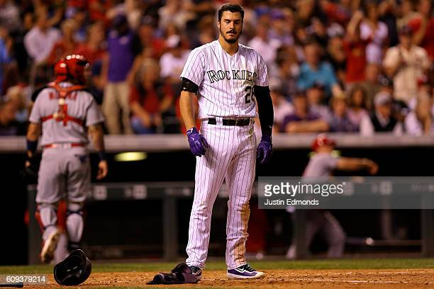 Nolan Arenado of the Colorado Rockies reacts after striking out during the fifth inning as Yadier Molina of the St Louis Cardinals walks off the...