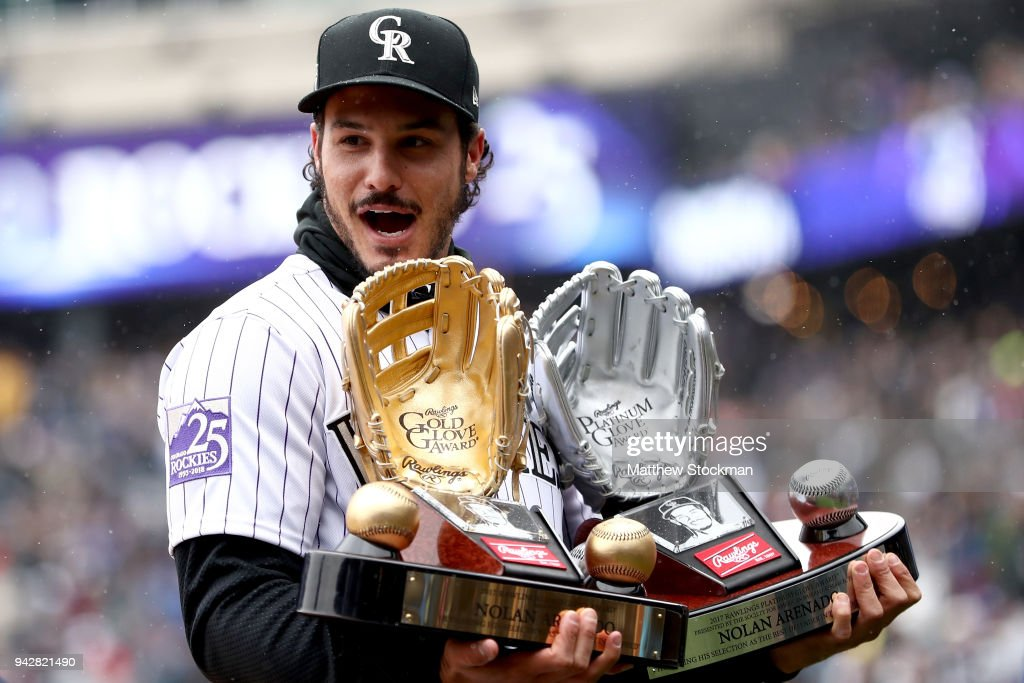 Nolan Arenado of the Colorado Rockies receives the Rawlings Gold Glove and Platinum Glove Award before the Rockies home opener against the Atlanta Braves at Coors Field on April 6, 2018 in Denver, Colorado.