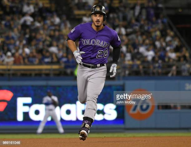 Nolan Arenado of the Colorado Rockies rounds second base after hitting a home run in the eighth inning against the Los Angeles Dodgers at Dodger...