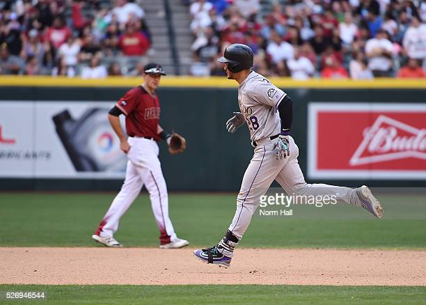 Nolan Arenado of the Colorado Rockies rounds the bases after after hitting a two run home run in the seventh inning against the Arizona Diamondbacks...