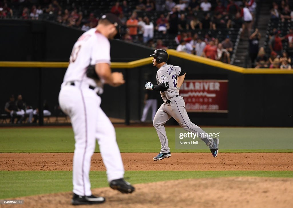 Nolan Arenado #28 of the Colorado Rockies rounds the bases after hitting a three run home run off of Jake Barrett #33 of the Arizona Diamondbacks during the eighth inning at Chase Field on September 11, 2017 in Phoenix, Arizona.