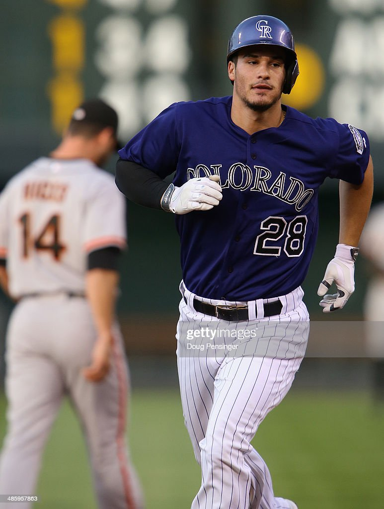 Nolan Arenado #28 of the Colorado Rockies rounds the bases on his solo homerun off of starting pitcher Ryan Vogelsong #32 of the San Francisco Giants to take a 1-0 lead in the first inning at Coors Field on April 21, 2014 in Denver, Colorado.