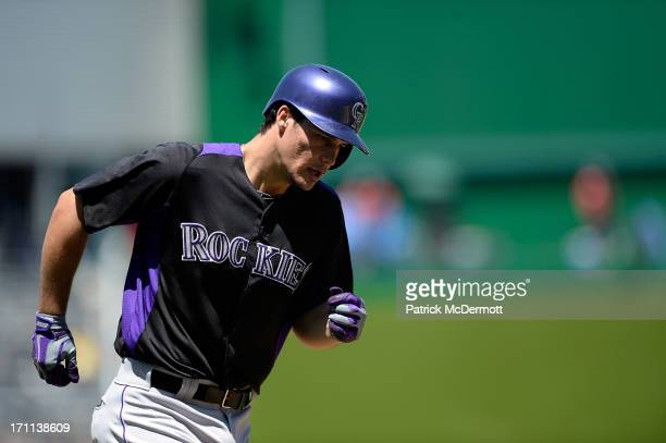 Nolan Arenado of the Colorado Rockies rounds third base after hitting a solo home run in the eighth inning during a game against the Washington...