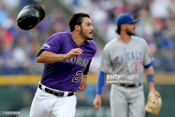Nolan Arenado of the Colorado Rockies rounds third base to score on a Daniel Murphy 2 RBI double in the first inning against the Chicago Cubs at...
