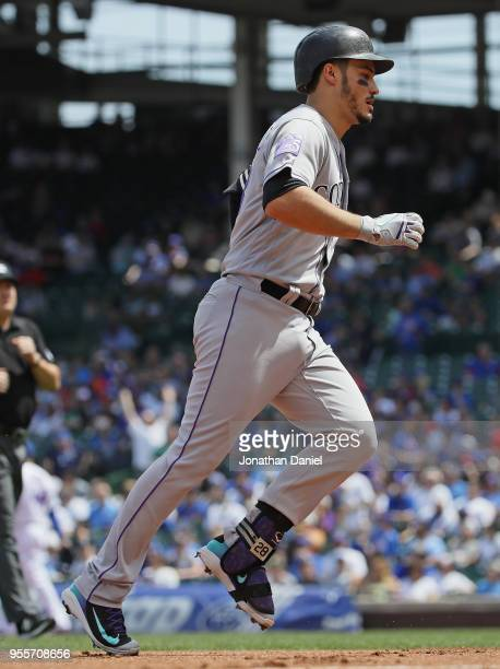 Nolan Arenado of the Colorado Rockies runs the bases after hitting a two run home run in the 1st inning against the Chicago Cubs at Wrigley Field on...