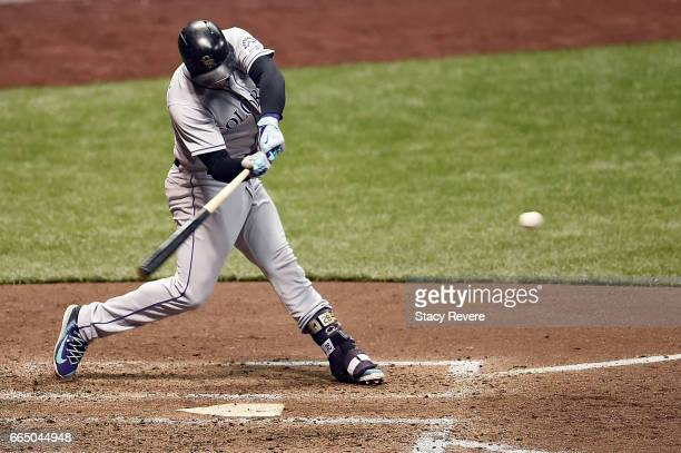 Nolan Arenado of the Colorado Rockies swings at a pitch during the sixth inning of a game against the Milwaukee Brewers at Miller Park on April 5...
