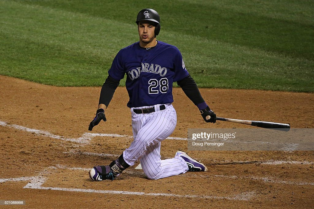 Nolan Arenado #28 of the Colorado Rockies swings for a strike against the San Francisco Giants at Coors Field on April 13, 2016 in Denver, Colorado. The Rockies defeated the Giants 10-6.