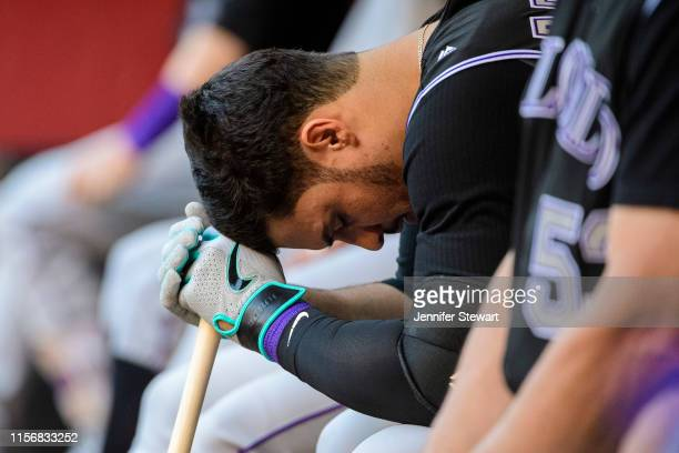 Nolan Arenado of the Colorado Rockies takes a moment in the dugout during a MLB game against the Arizona Diamondbacks at Chase Field on June 18 2019...