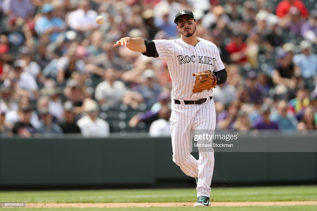 Nolan Arenado #28 of the Colorado Rockies throws out Andrelton Simmons #2 of the Los Angeles Angels of Anaheim in the sixth inning at Coors Field on May 9, 2018 in Denver, Colorado.