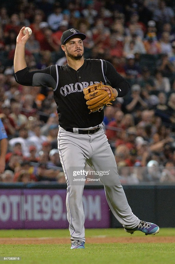 Nolan Arenado #28 of the Colorado Rockies throws the ball to make an out against the Arizona Diamondbacks at Chase Field on September 14, 2017 in Phoenix, Arizona.