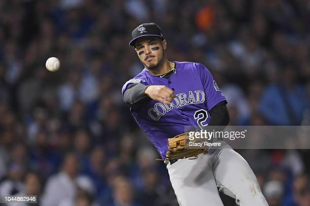 Nolan Arenado of the Colorado Rockies throws to first base in the fifth inning against the Chicago Cubs during the National League Wild Card Game at...