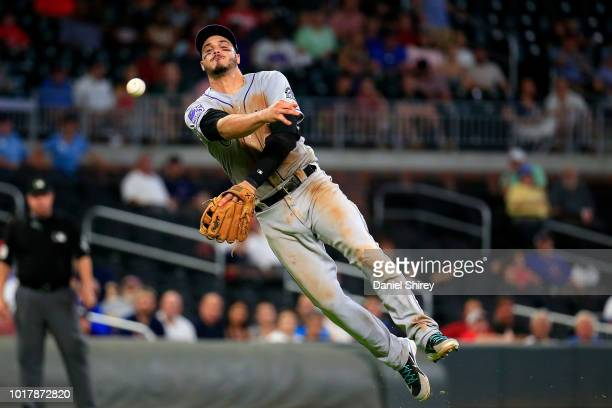Nolan Arenado of the Colorado Rockies throws to first for an out during the eighth inning against the Atlanta Braves at SunTrust Park on August 16...