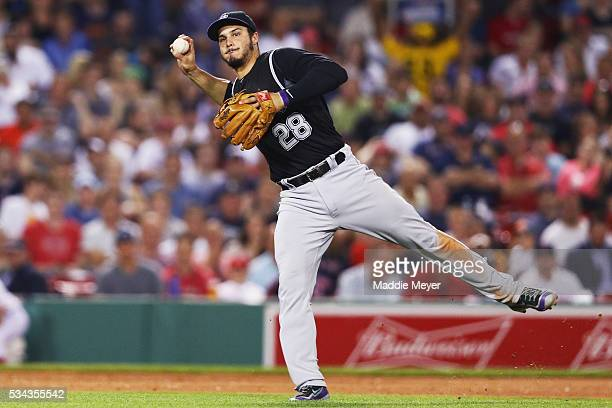 Nolan Arenado of the Colorado Rockies throws to first to force out Hanley Ramirez of the Boston Red Sox during the seventh inning at Fenway Park on...