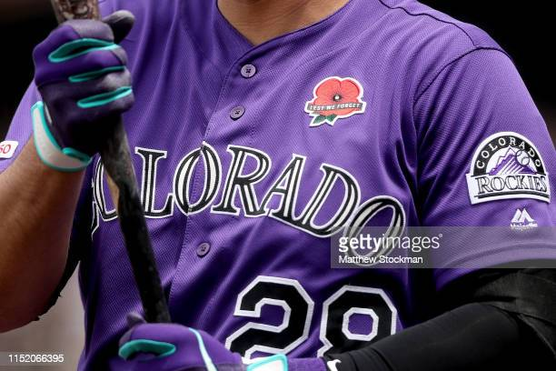 Nolan Arenado of the Colorado Rockies warms up in the on deck circle in the first inning against the Arizona Diamondbacks at Coors Field on May 27...
