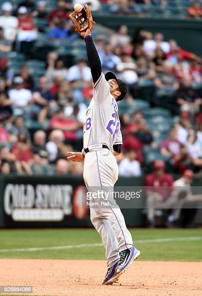 Nolan Arenado of the Colorado Rockies was able to get a force out at first base after making a leaping play on a bouncing ball during the eighth...