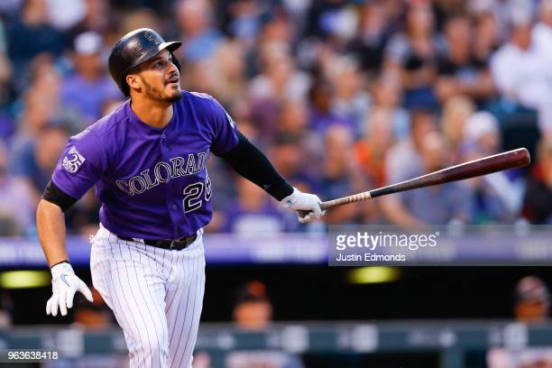 Nolan Arenado of the Colorado Rockies watches his RBI double during the fourth inning against the San Francisco Giants at Coors Field on May 29 2018...