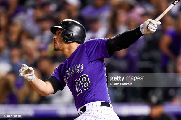 Nolan Arenado of the Colorado Rockies watches the flight of a sixth inning solo homerun against the Washington Nationals at Coors Field on September...