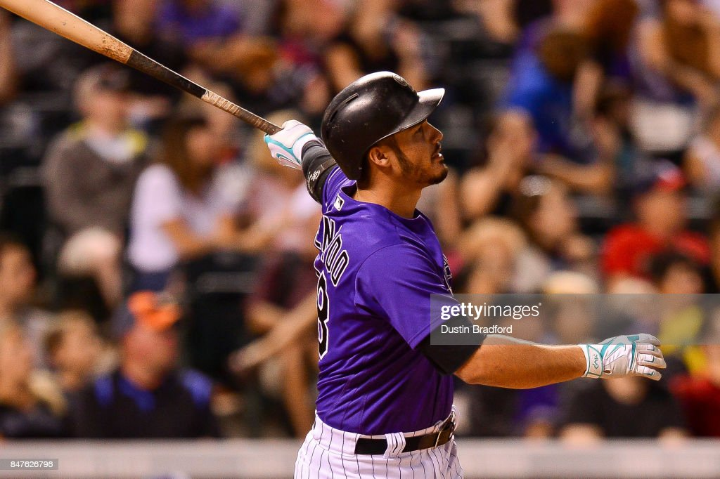 Nolan Arenado #28 of the Colorado Rockies watches the flight of an eighth inning solo homerun against the San Diego Padres at Coors Field on September 15, 2017 in Denver, Colorado.