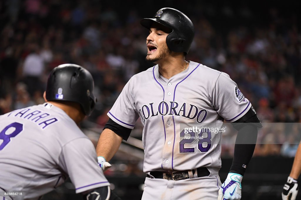 Nolan Arenado #28 of the Colorado Rockies yells at a fan sitting by the on-deck circle after hitting a three run home run off of Jake Barrett #33 of the Arizona Diamondbacks during the eighth inning at Chase Field on September 11, 2017 in Phoenix, Arizona.