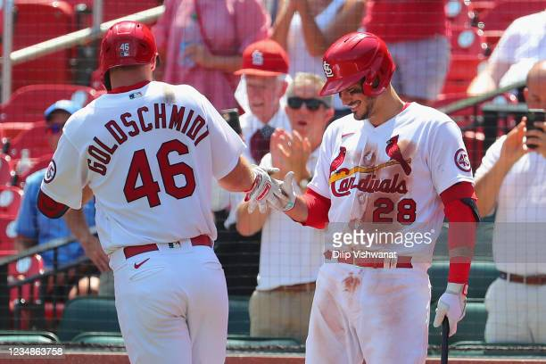 Nolan Arenado of the St. Louis Cardinals congratulates Paul Goldschmidt of the St. Louis Cardinals after Goldschmidt hit his second home run of the...