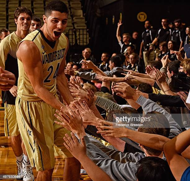 Nolan Cressler of the Vanderbilt Commodores high fives fans after a 7972 overtime victory over the Stony Brook Seawolves at Memorial Gym on November...