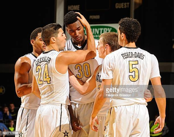 Nolan Cressler Riley Lachance and Matthew FisherDavis of the Vanderbilt Commodores huddle with teammate Damian Jones during the second half of a game...