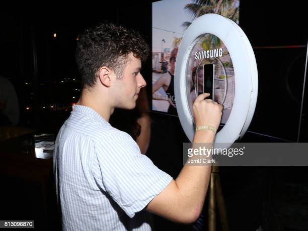 Nolan Gould interacts with the Samsung S8 photobooth at The Grand Opening Of The Highlight Room at DREAM Hollywood on July 11 2017 in Hollywood...