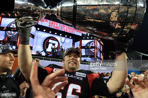 Nolan MacMillan of the Ottawa Redblacks hoists the Grey Cup following the 104th Grey Cup Championship Game against the Calgary Stampeders at BMO...